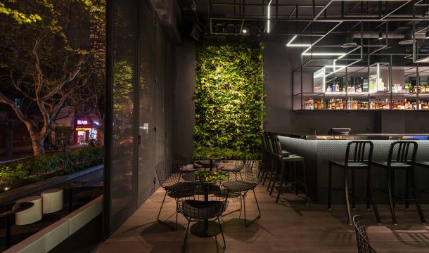 modern bar with black interior in shanghai, called The Botanist 2