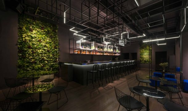 modern bar with black interior in shanghai, called The Botanist