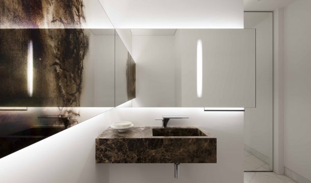Guest bath in a modern apartment with modern interior in almaty