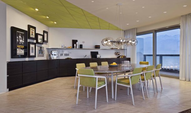 kitchen and dining room in a modern apartment in almaty 2