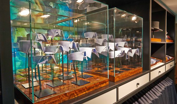 glass showcases with collars for Suitsupply fashion store in Zurich