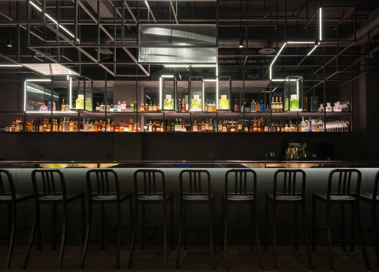 modern bar with black interior and extraordinary lighting in shanghai, called The Botanist